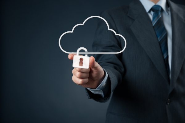 A man putting a lock onto an outline of a cloud