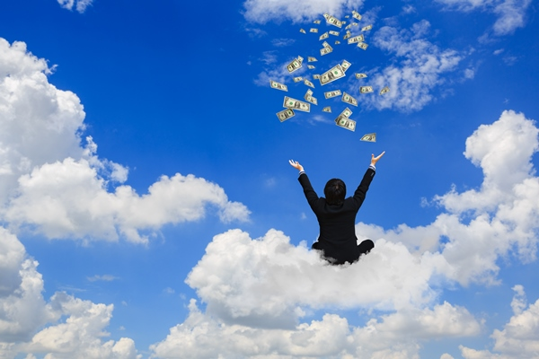 Man sitting on a cloud throwing money into the air