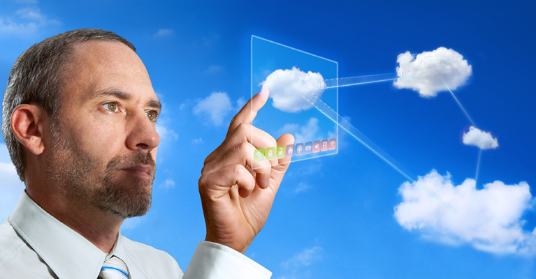 A man touching a virtual cloud