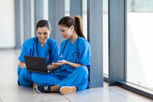 Two nurses using a laptop