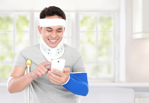 Injured man using a smartphone