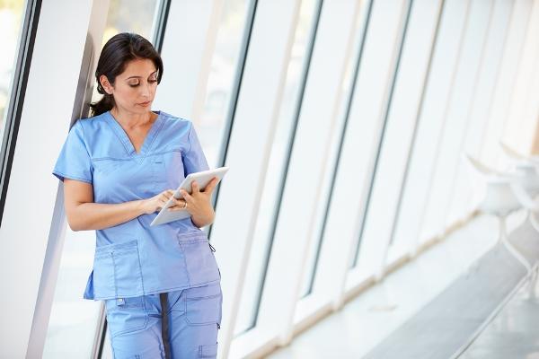 A nurse using a tablet