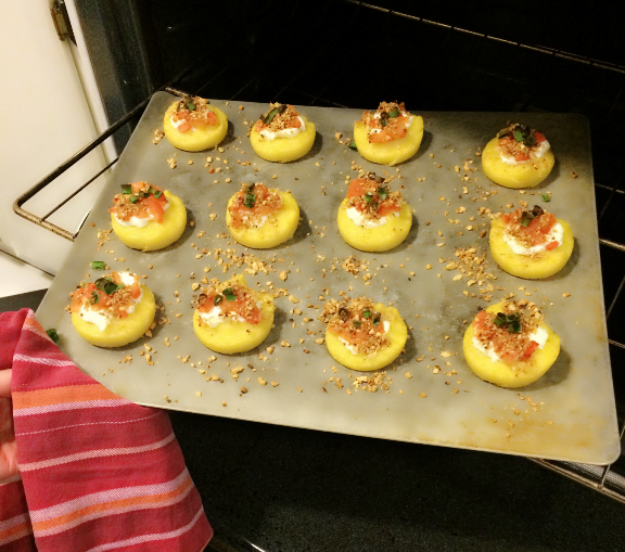 Polenta Bites With Blue Cheese, Tomatoes and Pine Nuts on tray