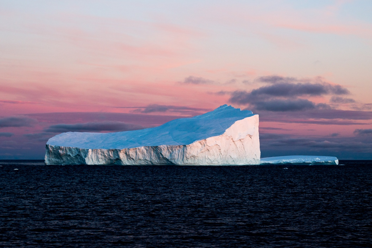 An iceberg in stark contrast to the warm sky in Baffin Bay.