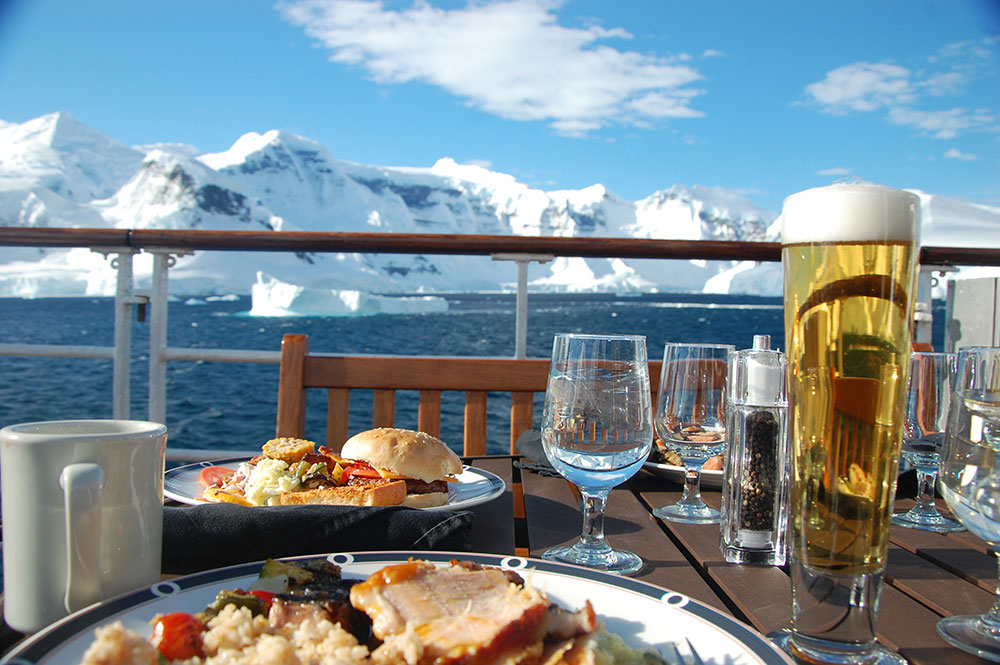 Passengers dine on deck in Antarctica when the weather permits.