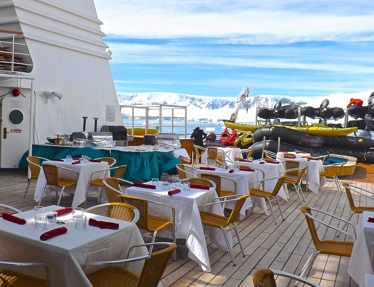 Expedition and hotel staff organize an outdoor meal in Antarctica.