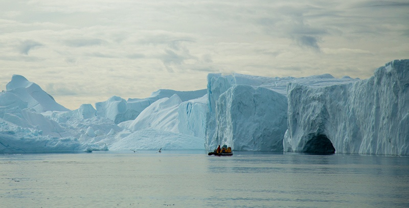 Passengers explore Greenland's Ilulissat Icefjord by Zodiac cruiser. Photo Acacia Johnson
