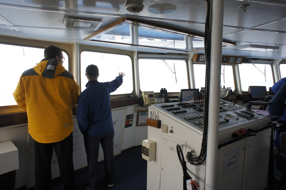 Naturalist and guide Jens Wikstrom explains the ice conditions ahead to a passenger onboard the Ocean Diamond.