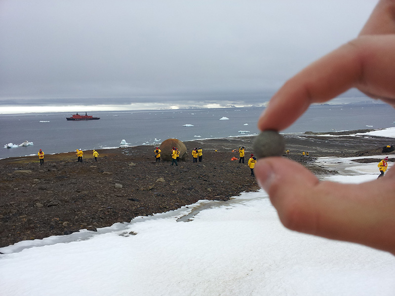 Quark passengers explore a frigid Champ Island rock beach mysteriously littered with spherical stones of varying sizes in Franz Josef Land.