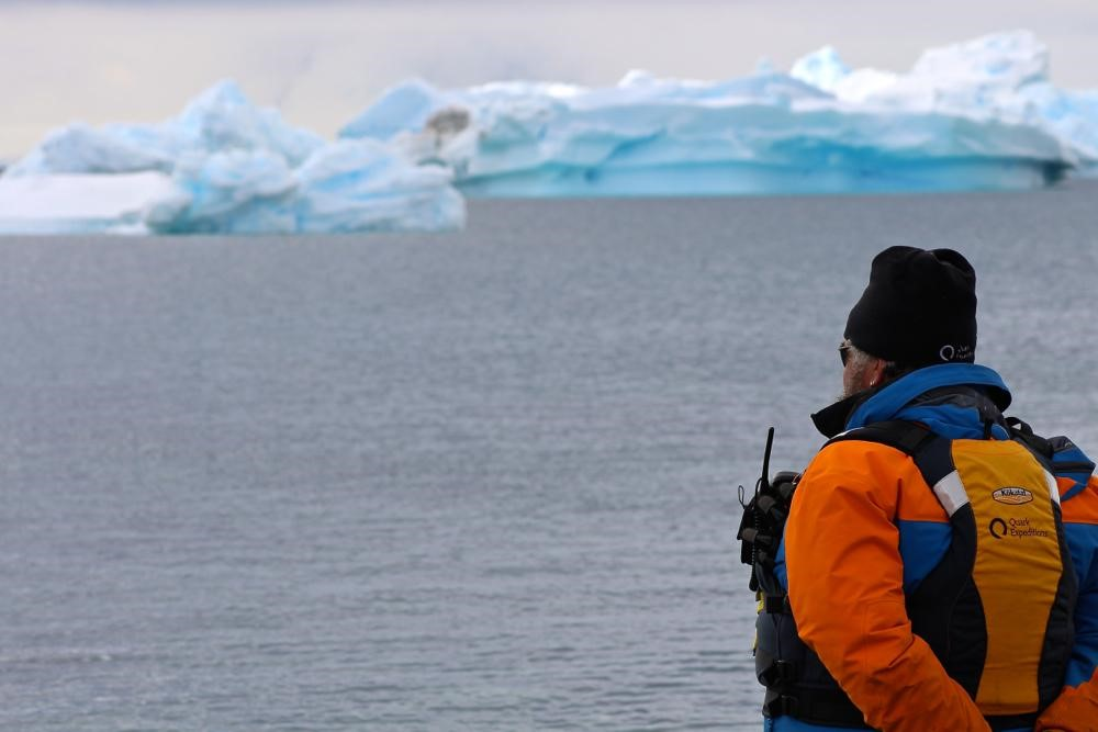 Expedition Leader Shane Evoy keeps a watchful eye over the Zodiac disembarkation on a shore landing in Antarctica.