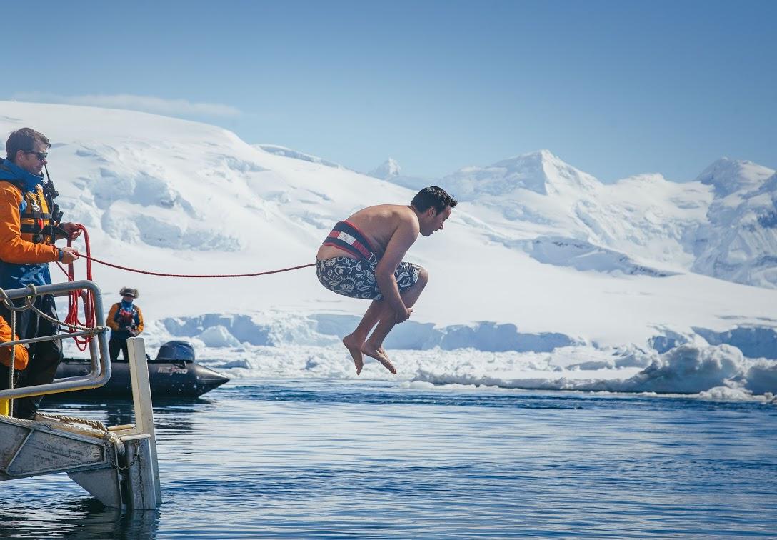Passenger Craig Shaw takes the plunge, cannonballing into frigid Antarctic waters. Photo: Amanda Wells