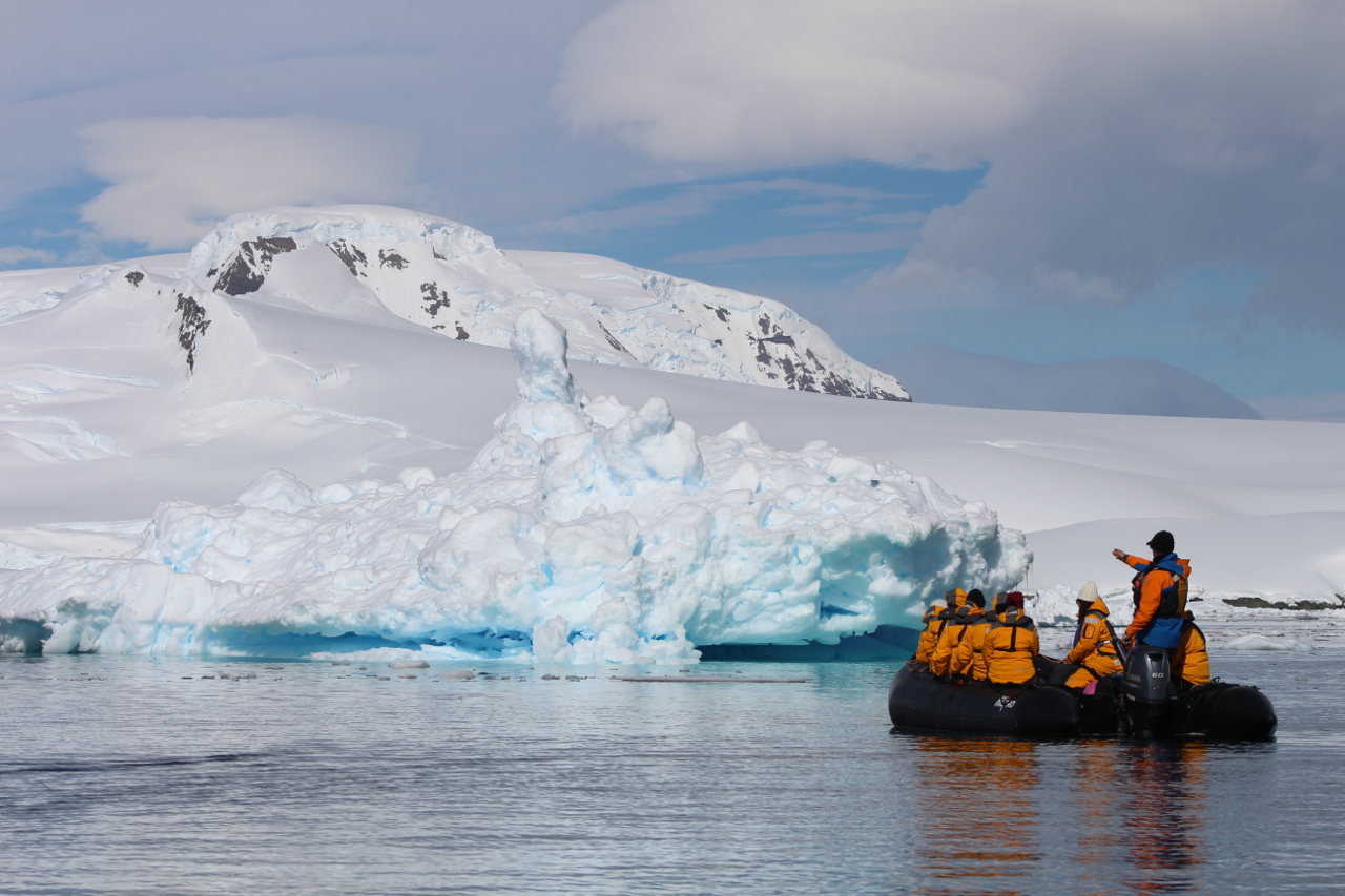 Passengers learn about the unique ecosystem of the Southern Ocean and Antarctica Peninsula while Zodiac cruising in Antarctica.