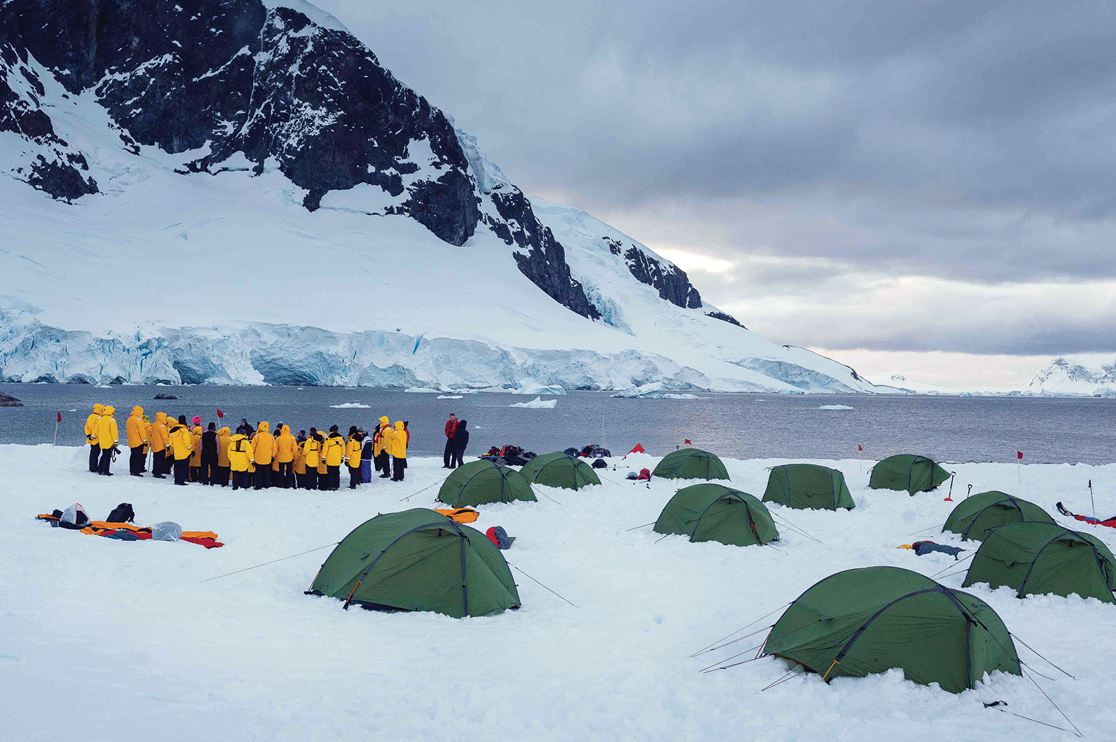 Campers get ready for a night sleeping under the Antarctic sky.