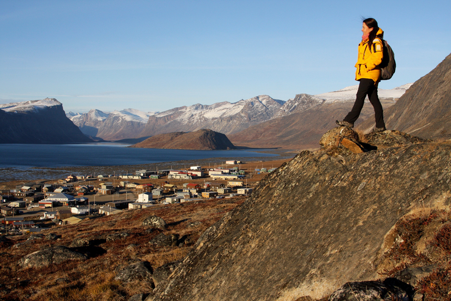A Quark passenger looks over the town of Pangnirtung on Baffin Island.