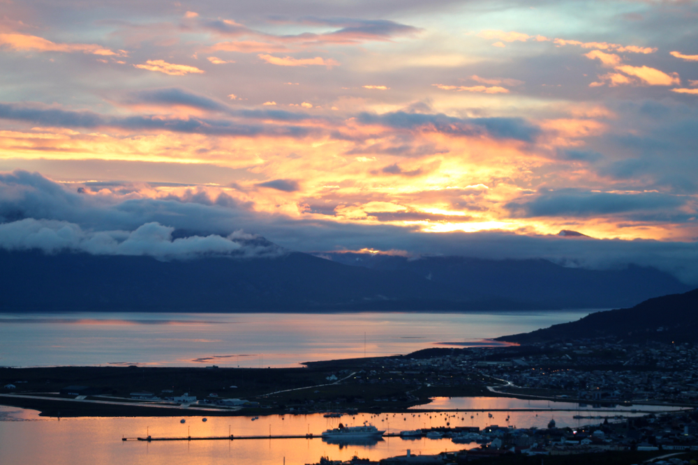 A fiery sunset lights up the port of Ushuaia just after the Ocean Diamond's departure on December 21 2016, as a brand new expedition group heads into the Drake Passage.