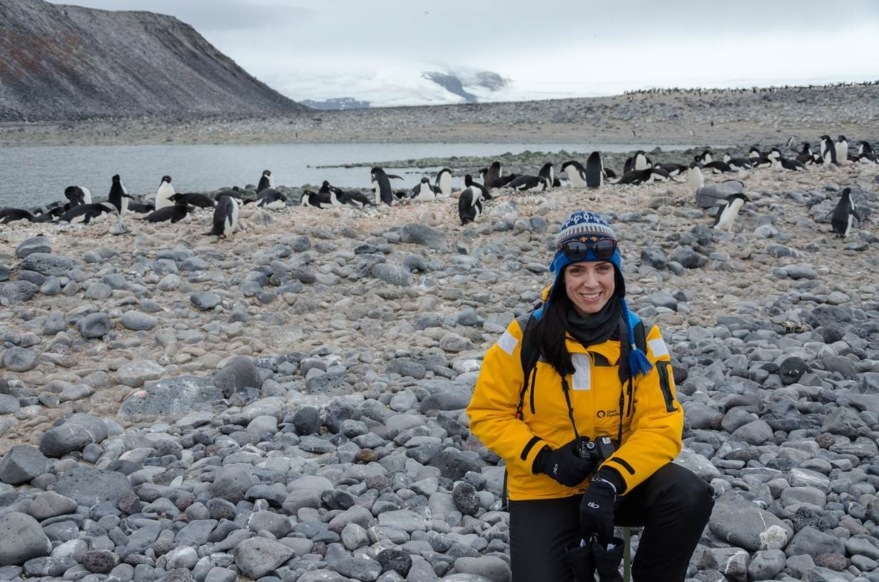 Nadine Ponte shares the shot with a colony of penguins on an Antarctic beach. Photo: Nadine Ponte