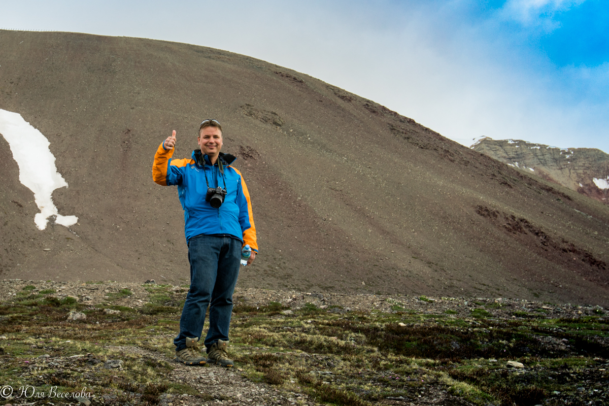 Hans Lagerweij gives the view from high atop the Arctic tundra in Svalbard a thumbs up on his recent expedition with Quark.
