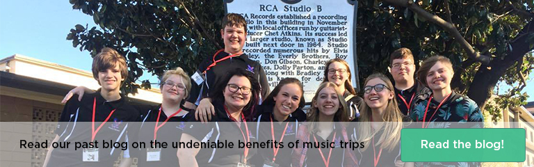 10 band students wearing black shirts and red lanyards, standing in front of a sign at the RCA Studio. Text: Read our past blog post on the undeniable benefits of music trips, Read the blog!