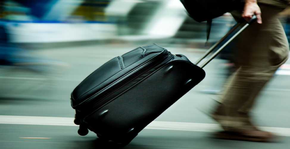 A trusted traveler hurrying through the airport. Business Travel. Flight Delays. Travel Management