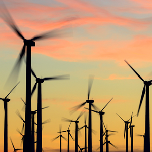 A wind farm generating electricity can help businesses meet commercial sustainability targets